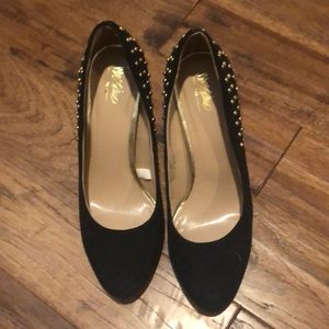 Black suede heels with gold studs on back